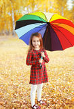 Beautiful little girl child with colorful umbrella in autumn Royalty Free Stock Photos