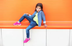 Beautiful little girl child wearing a checkered shirt Royalty Free Stock Photos