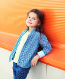 Beautiful little girl child wearing a checkered shirt over colorful background Stock Photos