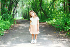 Beautiful little girl child wearing a dress in summer Stock Photo