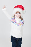 Beautiful little girl with Christmas cup Stock Image