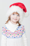 Beautiful little girl with Christmas cup Stock Images