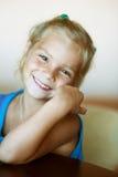 Beautiful little girl close-up. Portrait of funny beautiful little girl close-up, sitting on table Stock Photos