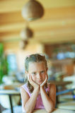 Beautiful little girl close-up. Portrait of beautiful little girl close-up, sitting on table Royalty Free Stock Photography