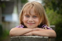 Beautiful little girl. Close-up portrait of a beautiful little girl with sparkling eyes and smile Stock Images
