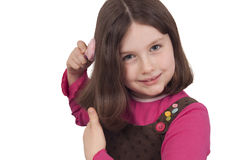 Beautiful little girl combing Stock Photo