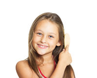 Beautiful little girl combing Royalty Free Stock Photos