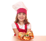 Beautiful little girl cook Stock Images