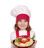 Little girl cook hold dish with spaghetti Stock Images