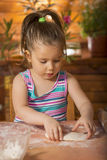Beautiful little girl cooking Stock Photo