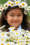 Beautiful little girl with crown of daisies Stock Photography
