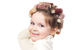 Beautiful little girl with curlers on her head. Stock Photography