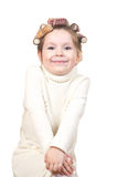 Beautiful little girl with curlers on her head. Stock Images