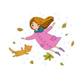 Beautiful little girl and a cute cartoon cat flying with autumn leaves. Stock Image