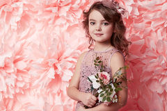 Beautiful little girl in cute dress with flower Royalty Free Stock Images