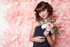 Beautiful little girl in cute dress with flower Stock Images