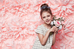 Beautiful little girl in cute dress with flower Royalty Free Stock Image