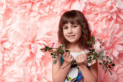 Beautiful little girl in cute dress with flower Royalty Free Stock Photo