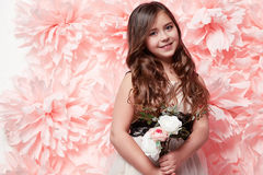 Beautiful little girl in cute dress with flower Stock Photography