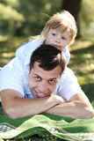 Beautiful little girl with dad Stock Images