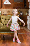 Beautiful little girl dancing in middle of lroom. Beautiful little girl dancing in middle of living room Stock Photography
