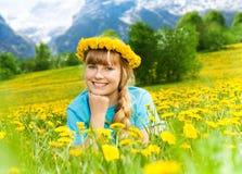 Beautiful little girl in dandelions Royalty Free Stock Photos