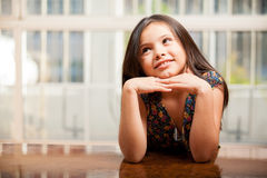 Beautiful little girl daydreaming Stock Photo