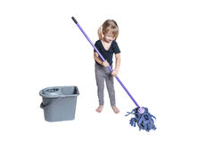 Beautiful Little Girl Doing Spring Cleaning with Mop and Bucket Royalty Free Stock Image