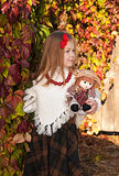 Beautiful little girl with doll Stock Images