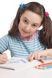 Beautiful little girl drawing Stock Photo