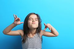 Little girl in dress. Beautiful little girl in dress on blue background Stock Photos