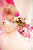 Beautiful little girl in dress. Beautiful little girl in white dress with flowers Royalty Free Stock Photography