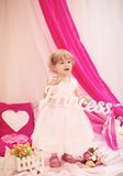 Beautiful little girl in dress. Beautiful little girl in white dress with flowers Royalty Free Stock Images