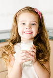 Beautiful little girl drinking milk Royalty Free Stock Photo