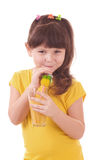 Beautiful little girl drinking orange juice Stock Images