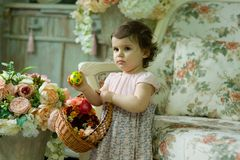 Beautiful little girl with Easter painted eggs stock photography