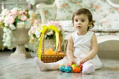 Beautiful little girl with Easter painted eggs stock photo