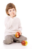 A beautiful little girl eat apples Royalty Free Stock Image