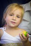 Beautiful little girl eating an apple Royalty Free Stock Image