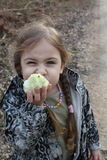 Beautiful little girl eating apple Royalty Free Stock Photography
