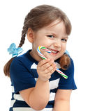 Beautiful little girl eating candy sweetness Stock Photos