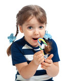 Beautiful little girl eating candy sweetness Stock Images