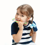 Beautiful little girl eating candy sweetness Royalty Free Stock Photo