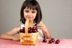 Beautiful little girl eating cherries Royalty Free Stock Photos