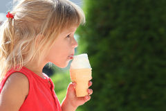 Beautiful little girl eating ice cream Royalty Free Stock Image