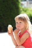 Beautiful little girl eating ice cream Stock Photo