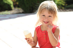 Beautiful little girl eating ice cream Royalty Free Stock Photography