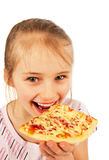 Beautiful little girl eating pizza Stock Images