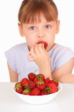 Beautiful little girl eating tasty strawberries Stock Images