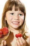 Beautiful little girl eating tasty strawberry Stock Image